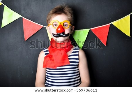 the boy in the costume of a clown - stock photo