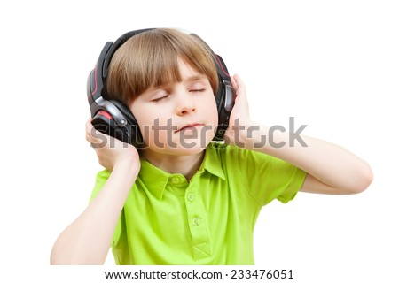 the boy in the headphones enjoy music with your eyes closed - stock photo