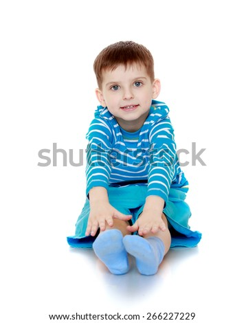 The boy in the striped T-shirt sitting on the floor. - isolated on white background