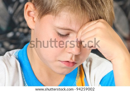 The boy in thought. Photos of the child - stock photo