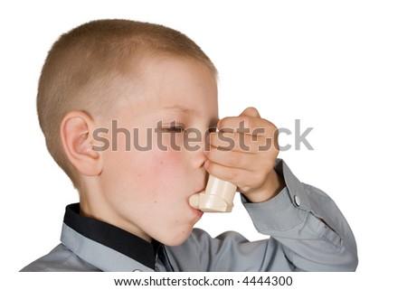 The boy injects an inhaler - stock photo