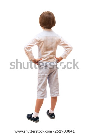 the boy is back in full length, isolated on white background  - stock photo