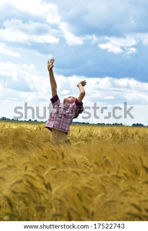 The boy is seeking to touch the sky - stock photo