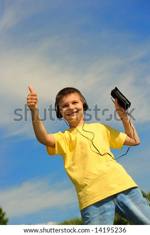 The boy listens to music - stock photo