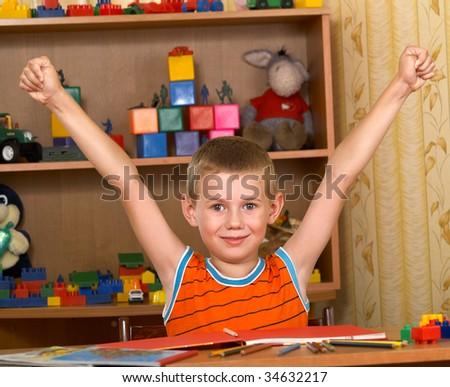 The boy of 7 years is engaged in a children's room