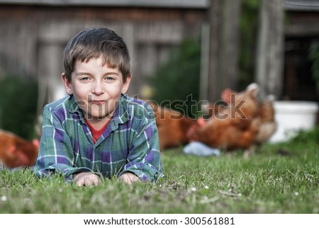 the boy on a poultry yard