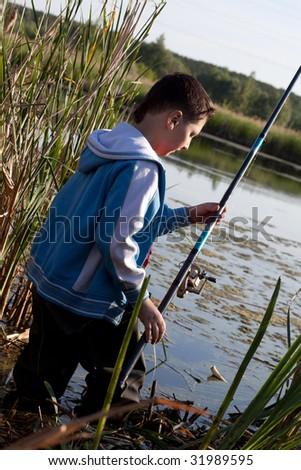 The boy on fishing - stock photo