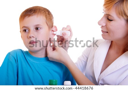 The boy on reception at the doctor - stock photo