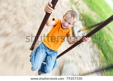 The boy on the playground - stock photo