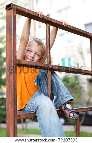 The boy on the playground - stock photo
