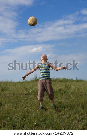 The boy play football by an old ball