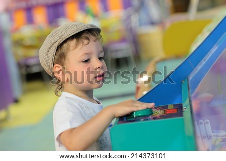 The boy playing in the amusement park