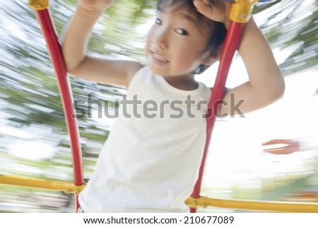 The Boy Playing On The Playground