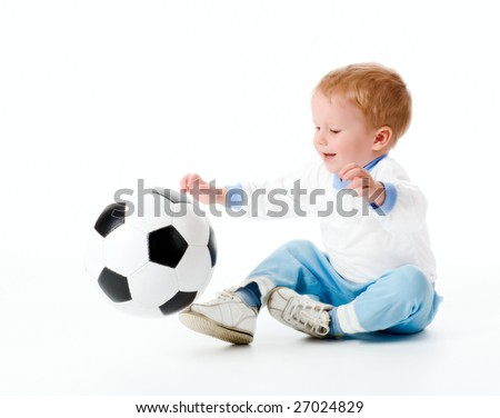 The boy plays with a football. On a white background. - stock photo