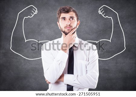 The boy represents in imagination what he strong - stock photo