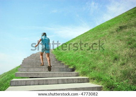 The boy runs on a ladder on background of sky - stock photo