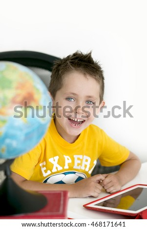 The boy's portrait with the globe behind a house desk