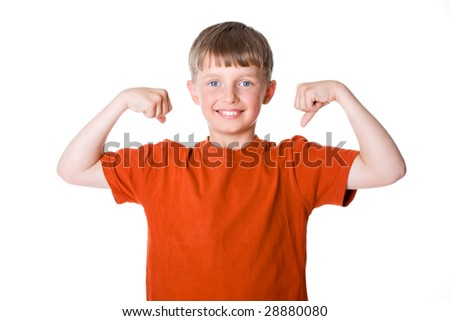 The boy shows his muscles
