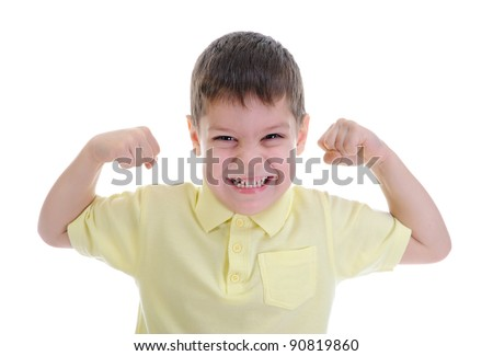 The boy shows his muscles. Isolated on a white background - stock photo