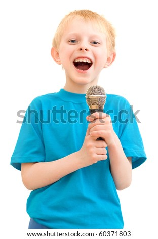 The boy sings with a microphone, a white background - stock photo