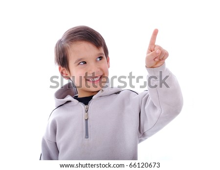 The boy smiles and shows a finger up, copy-space, you simply can put your digital button on top of his finger - stock photo