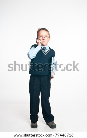 The boy speaks on the phone and has control over a folder for papers in hands on a white background - stock photo