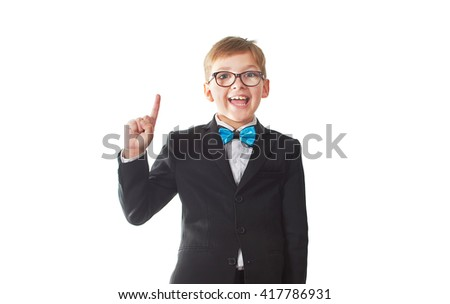 the boy student in a suit and tie with glasses standing isolated on white background with a raised finger - stock photo