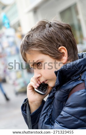The boy talking on the phone - stock photo