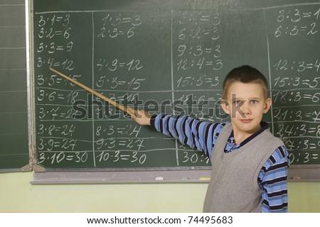The boy teaches the multiplication table - stock photo