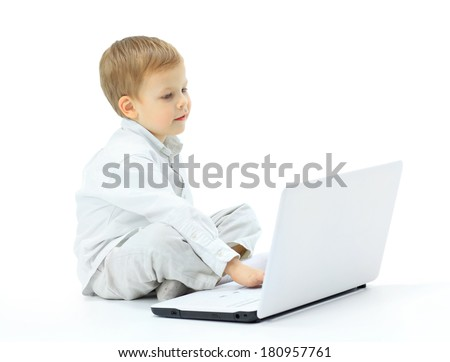 The boy using laptop - stock photo