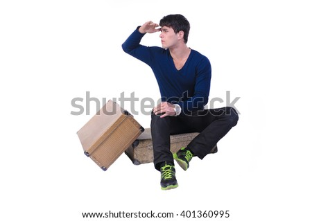 The boy waiting with baggage, isolated on white background, the man sitting on suitcases  with hand on his forehead looking far.