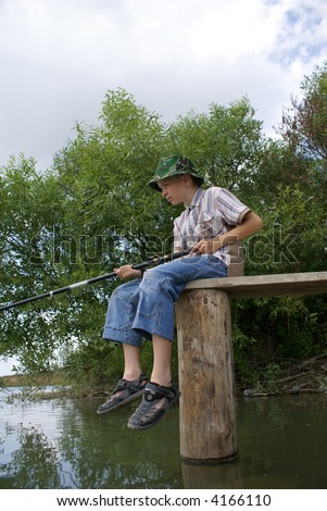 The boy waits when the fish will peck