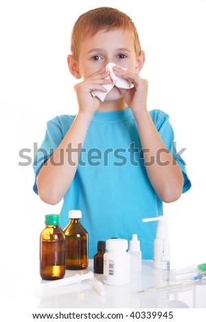 The boy wipes a napkihe nose - stock photo