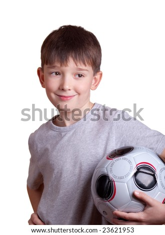 The boy with a football. Isolated on white. - stock photo