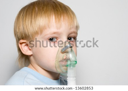 The boy with a mask on the face. - stock photo