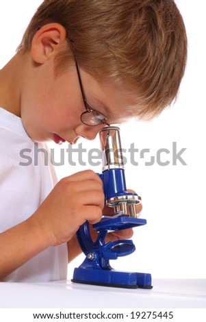 The boy with a microscope - stock photo