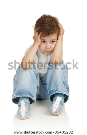 The boy with concentration somewhere looks - stock photo