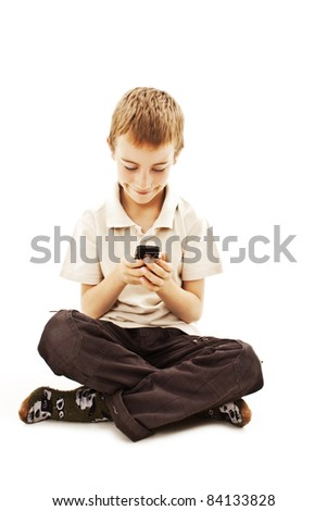 The boy with mobile phone.  All on white background. - stock photo