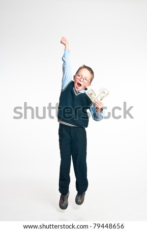The boy with money in hands on a white background - stock photo