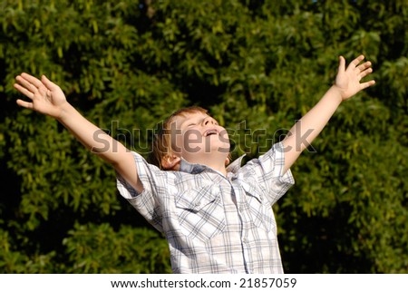 The boy with open hands lifted to sky - stock photo