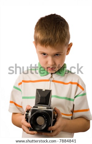 The boy with retro the medium format camera on a white background - stock photo