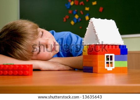 The boy with small house from blocks