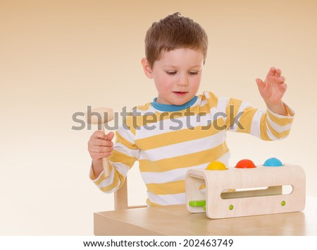 The boy with the desktop toy.passionate child for interesting occupation,active lifestyle,happiness concept,carefree childhood concept. - stock photo
