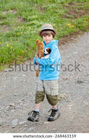 the boy with two baguettes is on the road