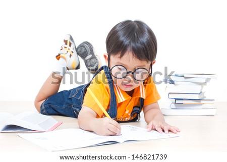 The boy writing homework from school in workbook  - stock photo