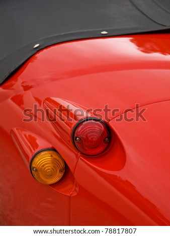 The brake and directional lights of a classic automobile - stock photo