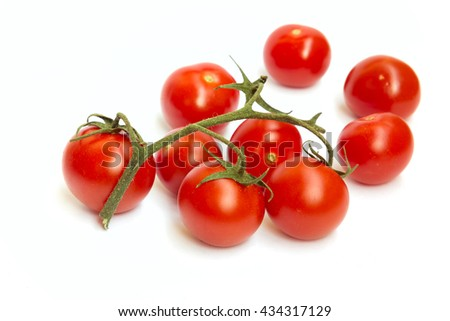 The branch of cherry tomatoes on white