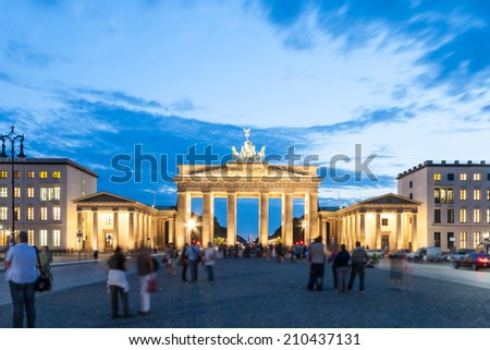 The Brandenburg Gate (German: Brandenburger Tor) is a former city gate, rebuilt in the late 18th century as a neoclassical triumphal arch, and now one of the most well-known landmarks of Germany. - stock photo