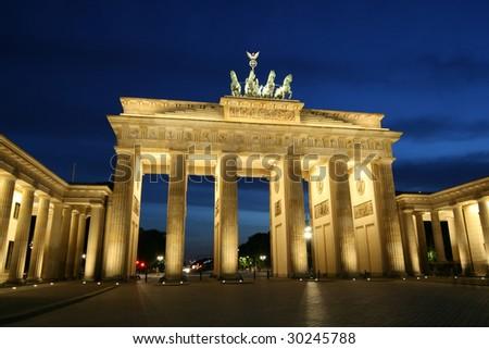 The Brandenburg gate in Berlin at night - stock photo