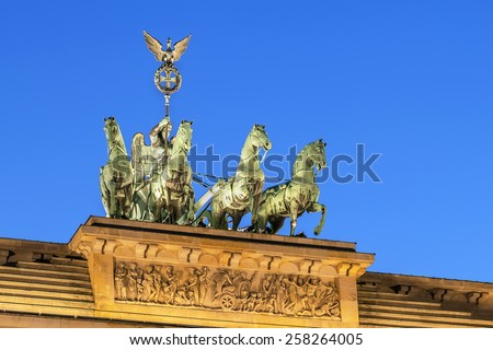The Brandenburg Gate is a former city gate, rebuilt in the late 18th century as a neoclassical triumphal arch, and now one of the most well-known landmarks of Germany. - stock photo